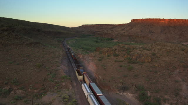 Two Freight Trains Passing Each Other in Arizona - Drone Shot
