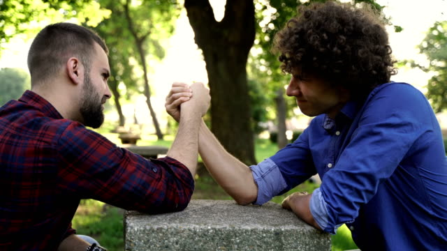 two friends arm wrestling - shivering stock videos & royalty-free footage