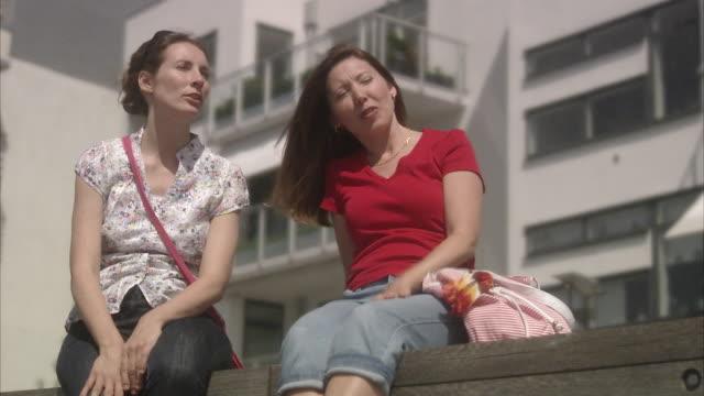 Two friends enjoying the sun Skane Sweden.
