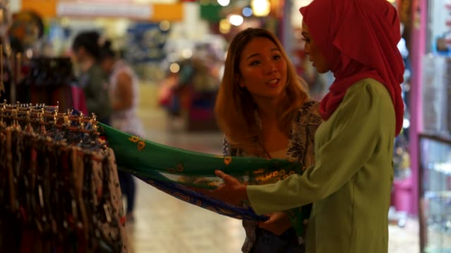 Two friends having shopping at the bazaar