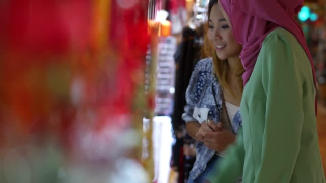 two friends having shopping at the bazaar - malaysian ethnicity stock videos & royalty-free footage