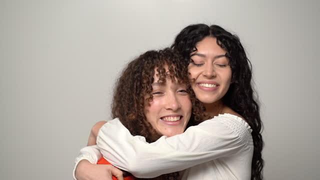 two friends hugging - brown hair stock videos & royalty-free footage