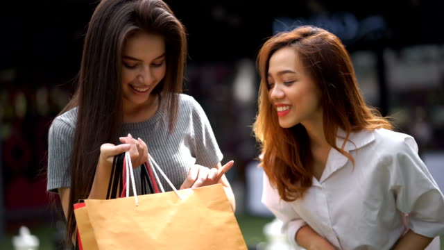 two friends in shopping - asia stock videos & royalty-free footage