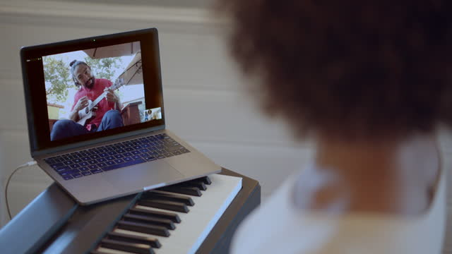 two friends meet via video conference and play music together. - 30 39 years stock videos & royalty-free footage