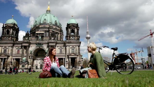 two friends relaxing in berlin - alexanderplatz stock videos & royalty-free footage