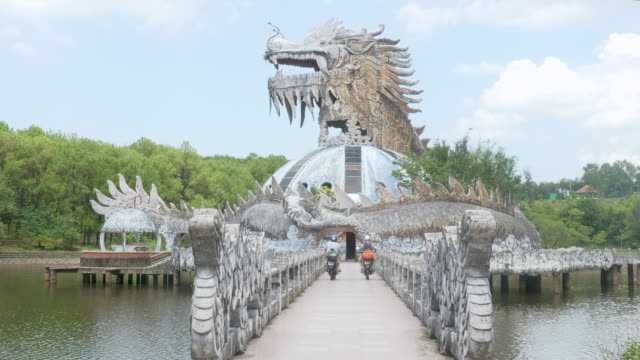 two friends riding a motorcycles over a bridge - vietnam stock videos & royalty-free footage