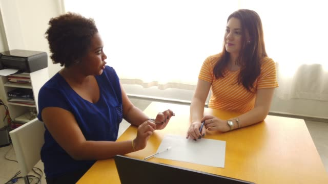 two friends talking about sitting in a office table. - business casual stock videos & royalty-free footage