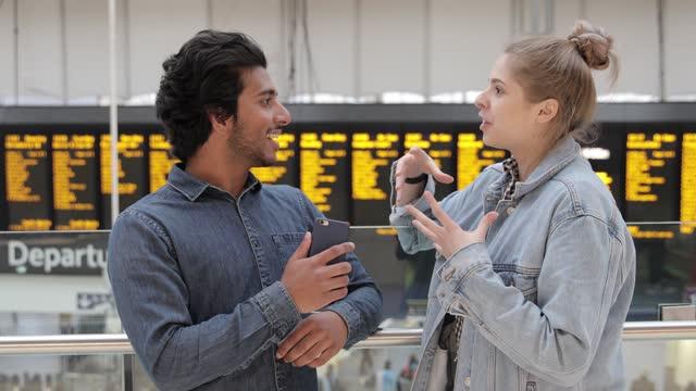 two friends talking in a train station - station bildbanksvideor och videomaterial från bakom kulisserna
