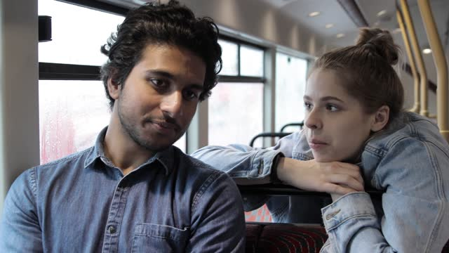 two friends talking while sitting inside of a bus in london, uk - public transport stock videos & royalty-free footage