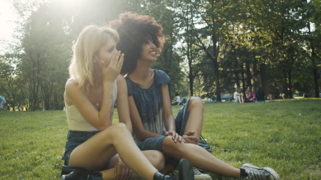 two friends together at the park - piercing video stock e b–roll