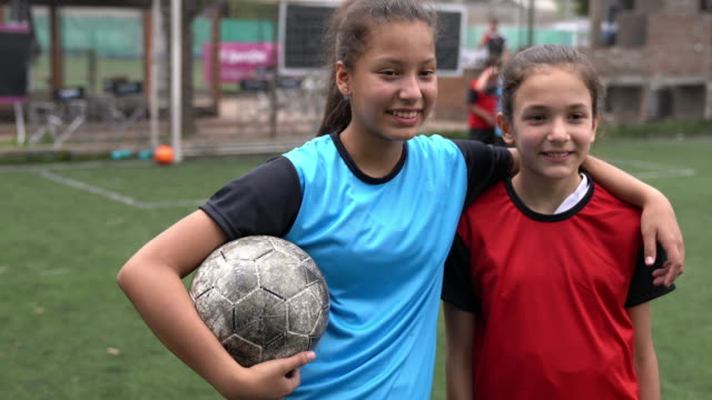 two friends together on a soccer field - girls stock videos & royalty-free footage