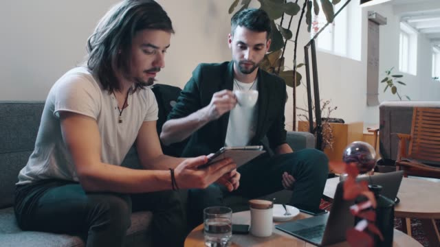 two friends using digital tablet at the cafe - cafeteria stock videos and b-roll footage