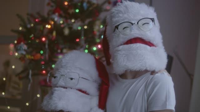 two funny christmas santas in eyeglasses - funny merry christmas greetings stock videos & royalty-free footage