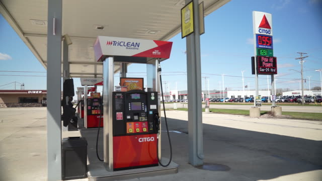two gas stations show the low price of gas at the pump in appleton wisconsin usa on tuesday april 21 2020 - tankstelle stock-videos und b-roll-filmmaterial