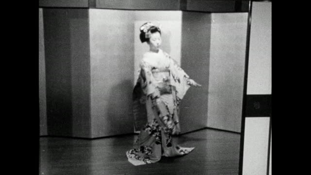 ws two geisha perform traditional dance in geisha house; 1966 - bbc archive stock-videos und b-roll-filmmaterial