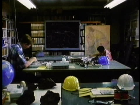 1970 ms two geologists working at desk / hawaii / audio - geologist stock videos & royalty-free footage