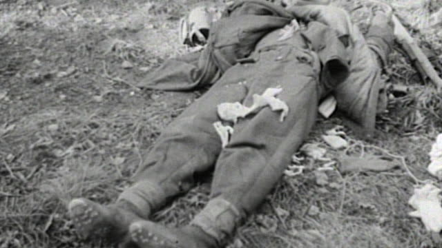 vidéos et rushes de pan two german army casualties lying where they fell / france - wehrmacht