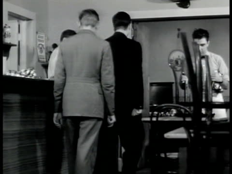two german men entering 'baumeyer' restaurant int vs men meeting baumeyer baumeyer leading them to back room closing doors vs men introducing each... - 1942 stock videos and b-roll footage