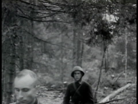 prisoners two german prisoners walking w/ two soviet soldiers in woods german nazi soldiers w/ hands raised coming out of blockhouse soviet russian... - menschliche gliedmaßen stock-videos und b-roll-filmmaterial