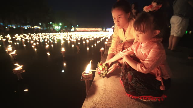 two girl in traditional thai dress in loi krathong festival - lantern stock videos & royalty-free footage