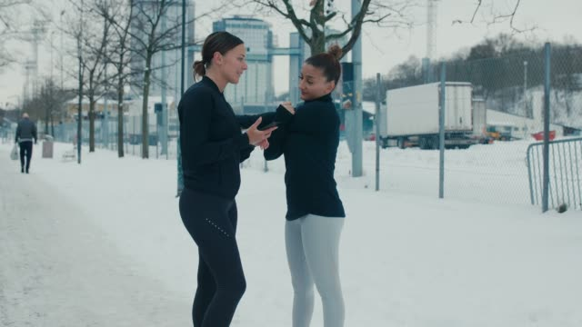 two girlfriends in sports clothes are stretching - peter snow stock videos & royalty-free footage