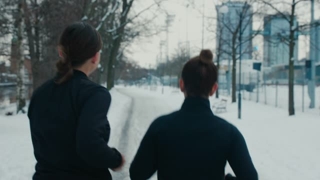 two girlfriends jogging in sports clothes - athlete stock videos & royalty-free footage