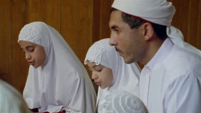 CU, ZI, Two girls (6-7, 8-9) and male teacher in religious school, Egypt