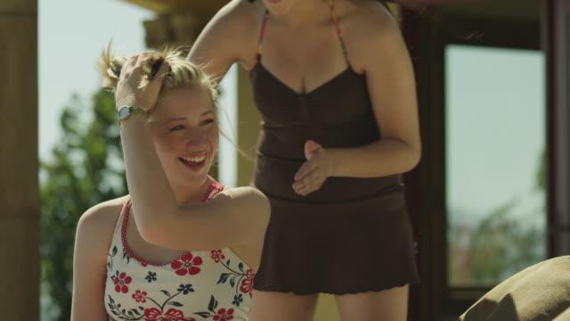 ms two girls (14-19) at poolside applying sunscreen / cedar hills, utah, usa - applying stock videos & royalty-free footage