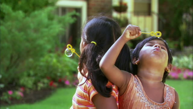 cu two girls (2-3, 6-7) blowing bubbles in garden, halifax, nova scotia, canada - see other clips from this shoot 1464 stock videos and b-roll footage