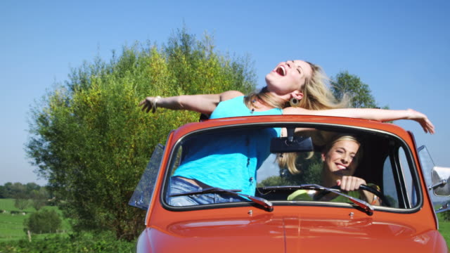 Two girls driving car