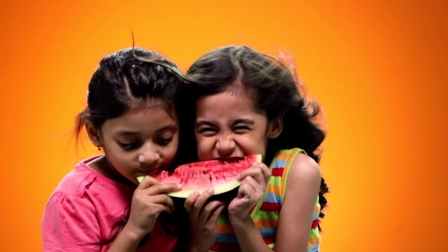 two girls eating watermelon - windswept stock videos & royalty-free footage