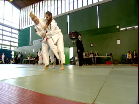 two girls fight during london towers judo competition one is thrown and pinned england - girls videos stock videos & royalty-free footage