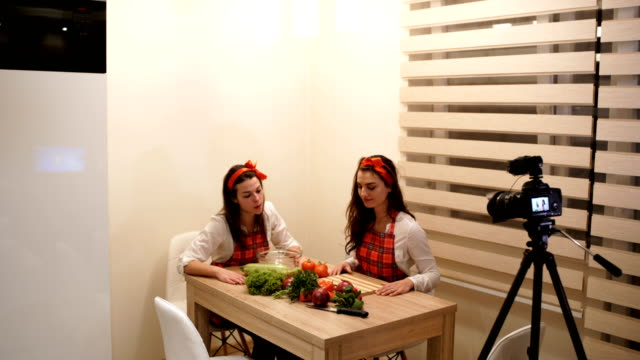 two girls filming video blog about tasty vegan food,recipe for vegan spaghetti - cinemanis videography stock videos & royalty-free footage