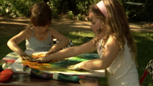 cu, zi, two girls (4-5) finger painting in garden - 4 girls fingerpainting stock videos and b-roll footage