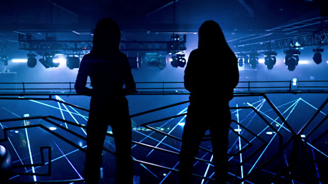 two girls have party in the vip balcony over ton of lasers - dj stock videos & royalty-free footage