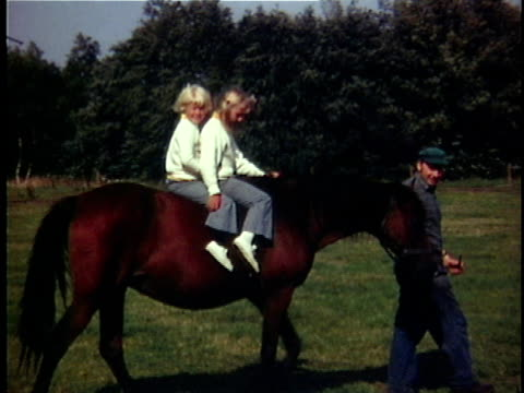 1970 WS Two girls (6-7, 8-9) horseback riding, Denmark