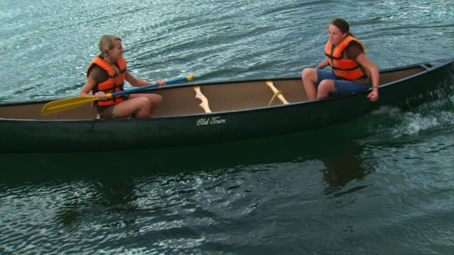 two girls in a canoe - see other clips from this shoot 1171 stock videos and b-roll footage
