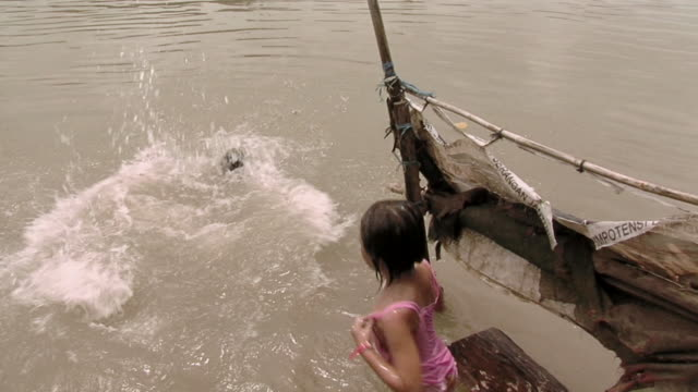 ms tu two girls jump into polluted river  / surabaya, east java, indonesia  - surabaya stock videos & royalty-free footage