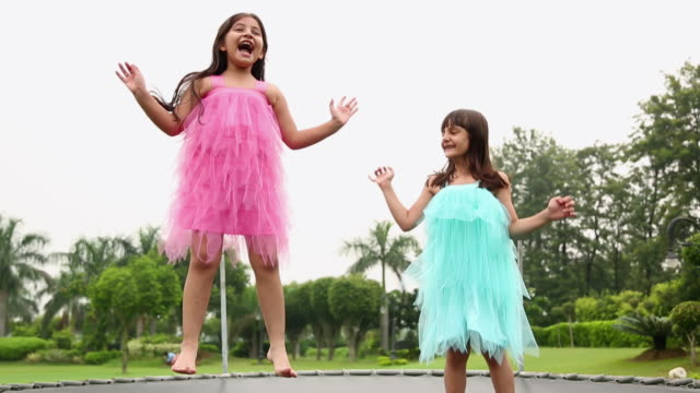 Two girls jumping on the Trampoline