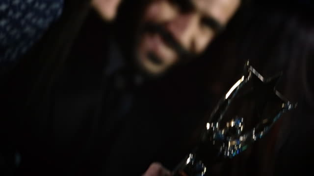 two girls kiss celebrity with awards trophy on cheek in back of limousine at awards show - academy of motion picture arts and sciences stock videos and b-roll footage