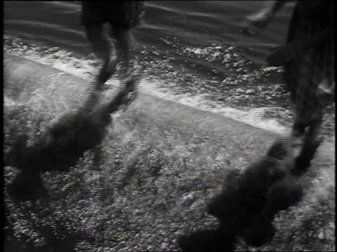 1939 montage two girls log rolling / longview, washington - cartwheel stock videos & royalty-free footage