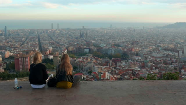 two girls looking at barcelona cityscape from carmel mountain park - viewpoint stock videos & royalty-free footage
