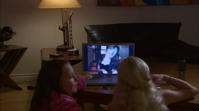 zi, cu, two girls (10-11) looking at halloween pictures on laptop, rear view - bathrobe stock videos & royalty-free footage