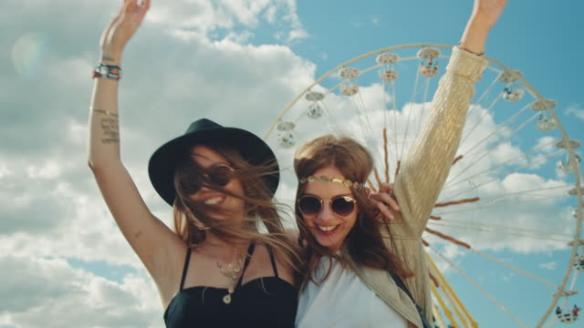 two girls on festival - ferris wheel stock videos & royalty-free footage