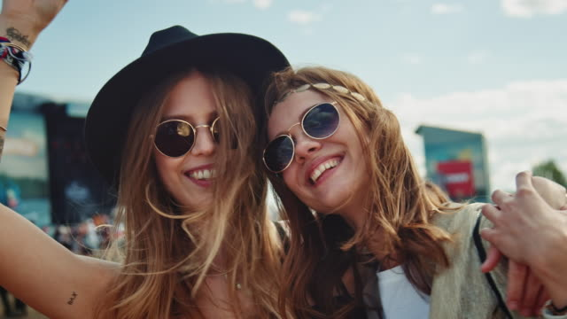 two girls on festival - sunglasses stock videos & royalty-free footage