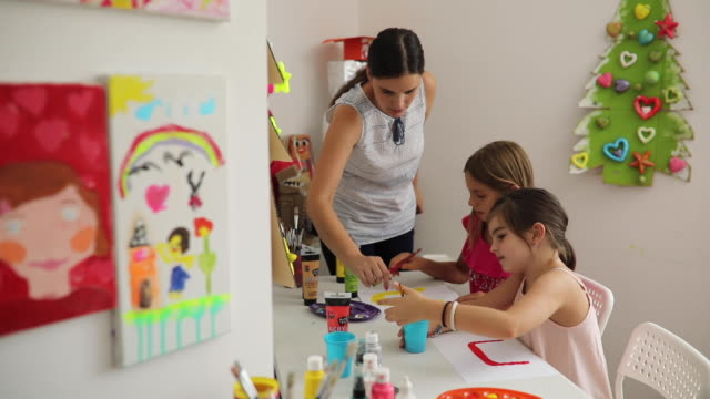 two girls painting on the art class - child care stock videos & royalty-free footage