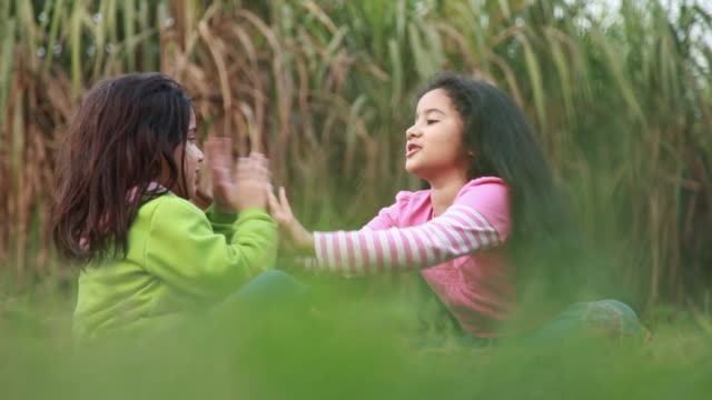 Two girls playing in the farms