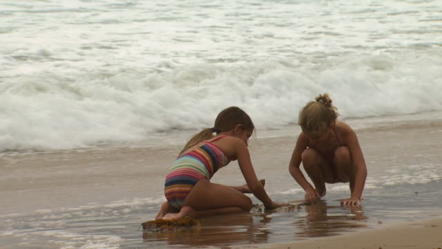 two girls playing in the sand and surf - see other clips from this shoot 1156 stock videos & royalty-free footage