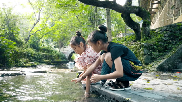 two girls playing near river - hamlet play stock videos and b-roll footage