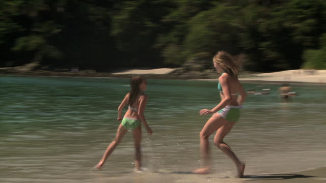 two girls playing on the beach - see other clips from this shoot 1158 stock videos & royalty-free footage